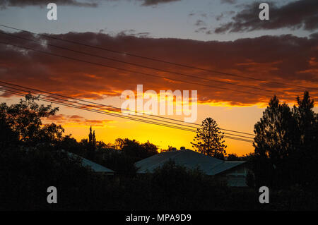 Tropical sunset over the suburbs of Brisbane, Queensland, Australia - Stock Image