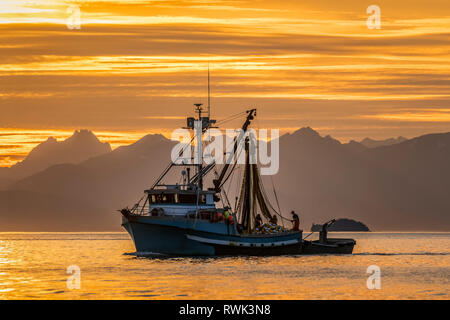 Seiner anchored in Amalga Harbor at sunset awaiting a commercial salmon opening, near Juneau, Southeast Alaska; Alaska, United States of America - Stock Image