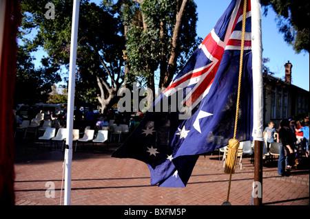 Australian flag flying during Anzac Day ceremony. Mundaring, Western Australia - Stock Image