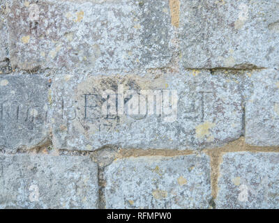 Graffiti carved into the walls of Portchester Castle, Hampshire, England, by Napoleonic Prisoners Of War - Stock Image