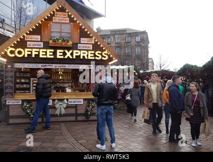 People wandering round enjoying the Christmas market stalls in St. Enoch Square, Glasgow, Scotland, UK, Europe - Stock Image