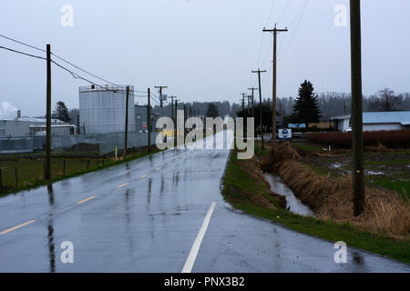 Wet country road in Abbotsford, British Columbia - Stock Image