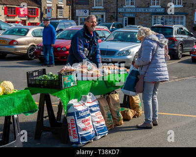 A woman buying eggs from  a farmer's market stall in Helmsley  North Yorkshire England UK - Stock Image