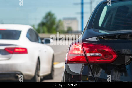 Traffic on road, rear car view displaying stop ligths - Stock Image