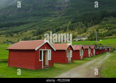Olden, Norway - 8 August 2018: Self-contained holiday shelters located on the outskirts  of the village of Olden at the end of the Nordfjord on 8 August 2018. The village of about 500 inhibitions engage in agriculture, fruit growing and manufacture for tourism. Photo: David Mbiyu - Stock Image
