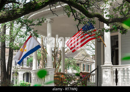 Garden District New Orleans, view of a typical porch with columns and flags flying in the upmarket residential Garden District of New Orleans, USA - Stock Image