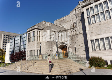 Woman climbing steps of the 1925 UBC Main Library building on the campus of the University of British Columbia, Vancouver, BC, Canada - Stock Image