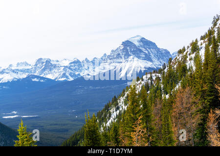 Snow-capped mountain landscape showing the Canadian Rockies at Lake Louise near Banff National Park in Alberta, Canada. - Stock Image