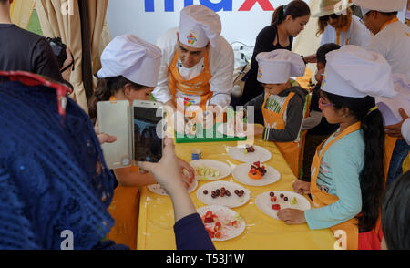 February 22, 2019 - Abu Dhabi, UAE: Little girls wearing chef hats are learning to become chef - Stock Image