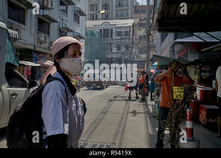 Woman wearing a facemask to protect against the smog in a Thailand street. Pattaya Southeast Asia - Stock Image