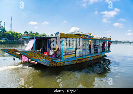 Tourists on a dragon boat sailing on the Perfume River. Hue, Thua Thien–Hue Province, Vietnam, Asia - Stock Image