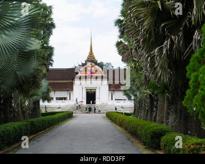 Main Museum entrance Luang Prabang Royal Palace and national museum is a set of temple  buildings in French colonial style dating back to  year 1904 - Stock Image