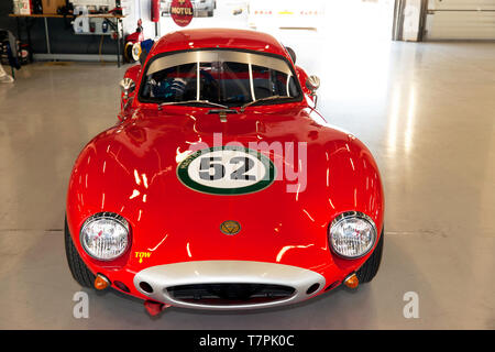Front View of Ron Maydon's Red, 1965, Ginetta G4R GT Car, in the International Pit Garages at the 2019 Silverstone Classic Media/ Test Day - Stock Image