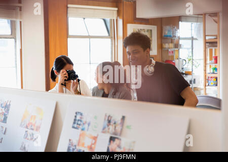 Photographers with camera working in office - Stock Image
