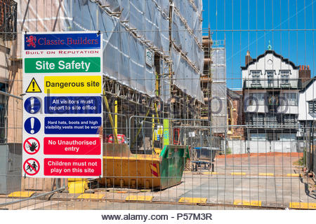 Building work continues in Exeter Cathedral yard, after the fire two years ago at the Royal Clarence Hotel, UK. - Stock Image