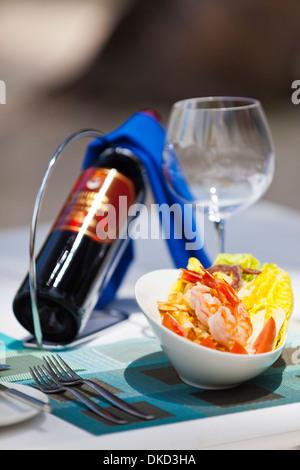 A prepared dinner table at Kuramathi Island Resort, Maldives - Stock Image