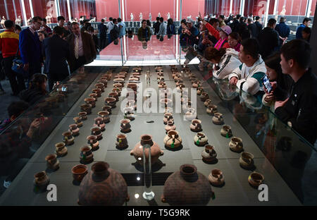 Beijing, China. 24th Apr, 2019. Visitors view cultural relics at the National Museum of China in Beijing, capital of China, April 24, 2019. Chinese cultural relics returned from Italy are on display at the National Museum of China in Beijing from April 24 to June 30. The exhibition, titled 'The Journey Back Home' showcases more than 700 pieces of returned Chinese artifacts. Credit: Li He/Xinhua/Alamy Live News - Stock Image