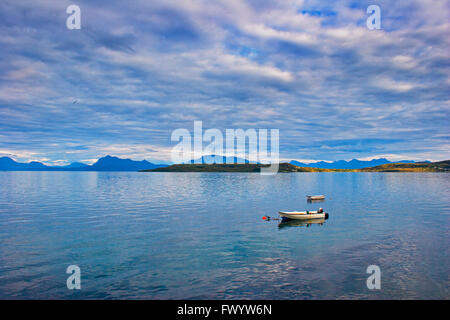 Two rowing boats are moored in a fjord near Harstad in northern Norway. - Stock Image