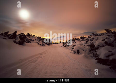 Scenic view of snowy landscape against sky - Stock Image