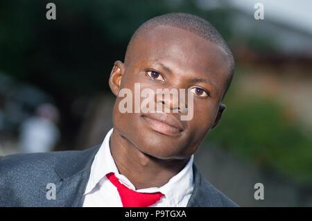 Close-up of young businessman looking at camera - Stock Image