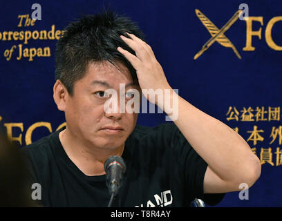 Tokyo, Japan. 15th May, 2019. Controversial Japanese entrepreneur Takafumi Horie?speaks during a news conference at the foreign correspondents club in Tokyo on Wednesday, May 15, 2019. Earlier this month, a private space company Horie and a group of investors founded successfully launched an unmanned rocket into space, achieving an altitude of 113 km in four minutes before dropping in the Pacific Ocean. The Interstellar Technologies is now developing a rocket that can put small satellites into orbit, and hopes to begin commercial operations in 2023. Credit: Natsuki Sakai/AFLO/Alamy Live News - Stock Image