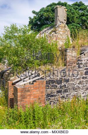 Ty-Rheinallt, a derelict ruined farm at Garn-yr-erw, Blaenavon, Torfaen, Gwent, Wales, UK, affected by mining subsidence. - Stock Image