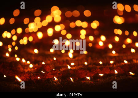 Beautiful earthen traditional lamps put in a garden lawn during Diwali festival celebration, in India. - Stock Image