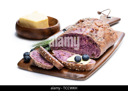 Blueberry  and chia seed bloomer isolated on white - Stock Image