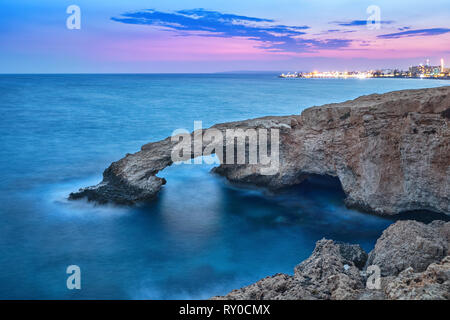 Love Bridge - picturesque natural formation creating a rock arch in Ayia Napa, Cyprus - Stock Image