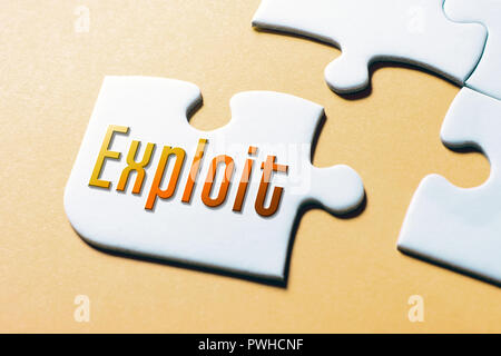 The Word Exploit In Missing Piece Jigsaw Puzzle - Stock Image