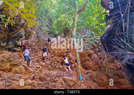People climbing towards Sa Phra Nang, Railay, Krabi province, Thailand - Stock Image