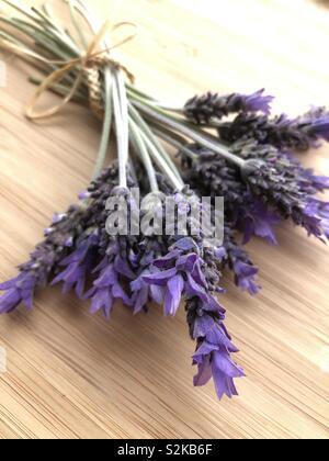 Lavender flowers on wood - Stock Image