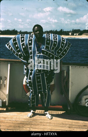 Man from Gabon in native dress, coast of West Africa; Gabon, Africa. - Stock Image