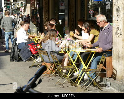 Office workers having lunch in the sun Munich Germany Europe - Stock Image
