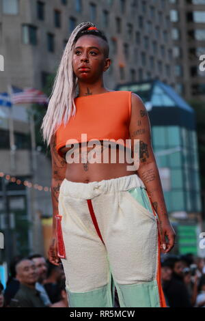 Montreal,Canada. A model poses on the runway at the Yung_Alexander fashion show held during the Fashion and Design Festival. - Stock Image