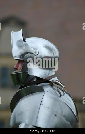 Knight in armour with helmet - Stock Image