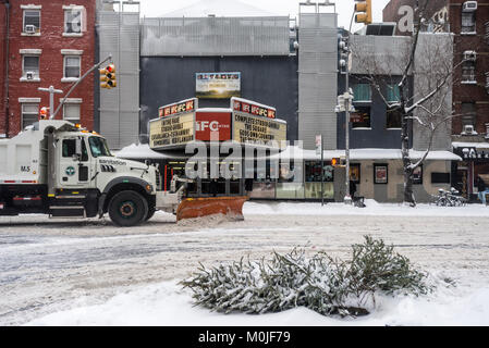 New York, NY 4 January 2018 - A Sanitation Department truck clears the snow on Sixth Avenue during the post CHristmas - Stock Image