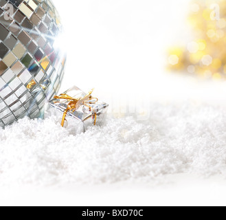 Christmas background with disco ball and gift package - Stock Image