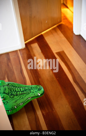 Inflatable crocodile series Lurking in the hall - Stock Image