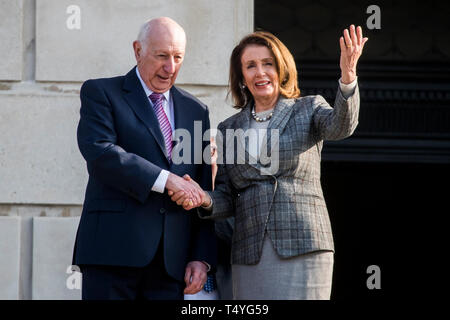 Nancy Pelosi, speaker of the United States of House of Representatives looks out onto Stormont Estate as she is greeted by Robin Newton, Speaker of the Northern Ireland Assembly, on the steps of Parliament Buildings in Belfast. - Stock Image