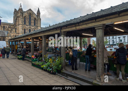 People shopping at The Shambles, a Grade II* covered market built in 1766 in Hexham Northumberland and in regular daily use - Stock Image