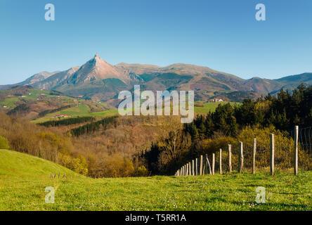 Txindoki mountain and valley from Lazkaomendi on sunny day - Stock Image