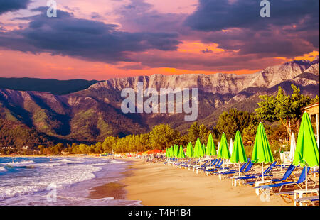Stunning sunset at Psili Ammos beach, Thassos island, Greece.It is known as Golden beach. It is situated between Skala Panagia and Skala Potamia. - Stock Image