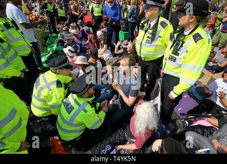 Extinction Rebellion demonstrators on Waterloo Bridge in London. - Stock Image