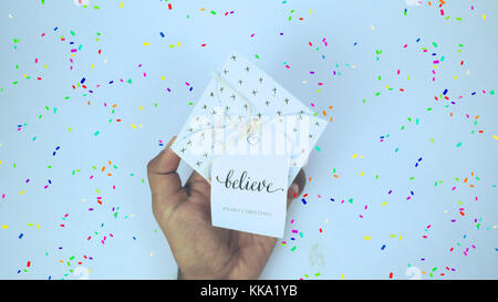 Giving Square Gift Box with colorful confetti around the gift box Best Photo for Background images - Stock Image