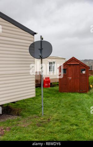 TV satellite dish on mobile home in caravan park, Ireland - Stock Image