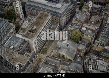 Ariel view of London City in England with various buildings and busy streets with intentional HDR toning and grain - Stock Image