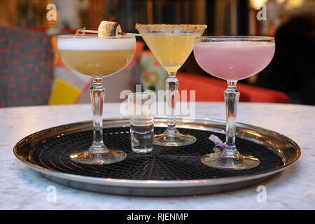Refinery Bar in the XYZ Building on Spinningfields, Manchester, Thursday 24th November 2016. Cocktail Bar. Tray of assorted cocktails. - Stock Image