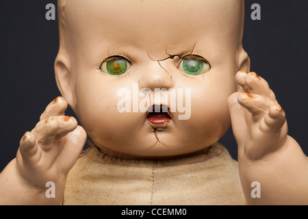 A scary-looking vintage infant doll. - Stock Image