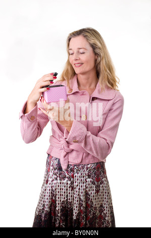 woman opening a gift box isolated on white - Stock Image